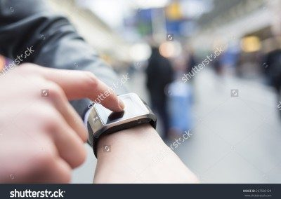 stock-photo-in-hall-station-a-man-using-his-smart-watch-app-close-up-hands-267560129-400x284